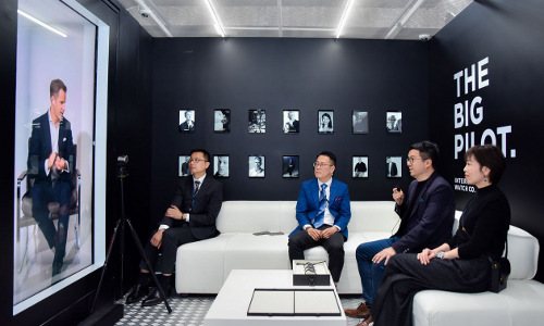 Cristoph Grainger-Herr (left), CEO of Swiss watch company IWC, appears in hologram form at a trade event.